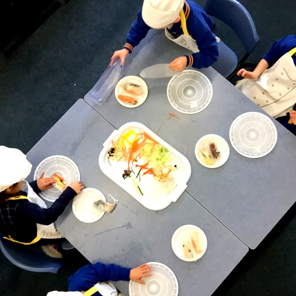 Rolling Fun - young students make veggie rice paper roll